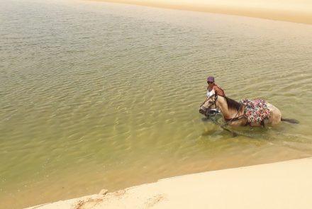 Horseback ride through Lençóis Maranhenses National Park